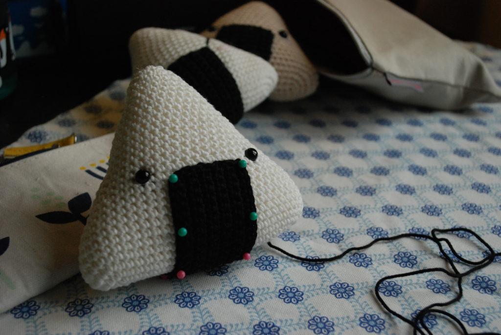 Pins on the nori of the crocheted onigiri